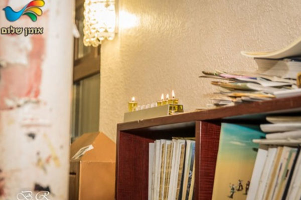 גלריית השבוע • צלם 'אומן שלום' מביא תיעוד מרחובותיה של אומן בחנוכה